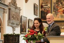 Yara Badr accepts the 2015 Luther Prize in Wittenberg on behalf of her husband, Mazen Darwish, photo: City of Wittenberg